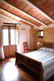 Dormitorio con mirador
